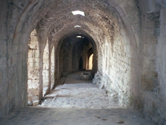 Exploring the long dark passages in the heart of the castle, Krak des Chevaliers