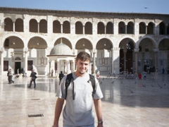Robby standing in front of the Dome of the Clock, Umayyad Mosque (one of the oldest and largest mosques in the world)
