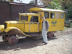 Robby next to a decomissioned train carriage at the Damascus Al Hejaz railway station