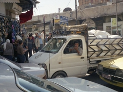 A Syrian claps his approval upon seeing our group exploring Damascus