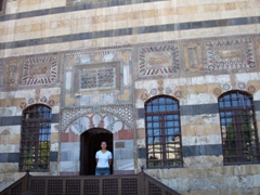 Becky stands inside the 18th century Al Azem Palace, Damascus