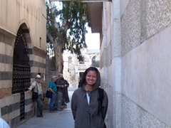 """Becky at the """"Putting on special clothes room"""" where she donned a robe to cover up, Umayyad Mosque (Great Mosque of Damascus)"""
