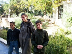 Two Syrian boys get a kick out of seeing Becky covered up at the Umayyad Mosque, Damascus