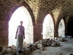 Becky standing in the archway of the Warehouse and Armory; Krak des Chevaliers