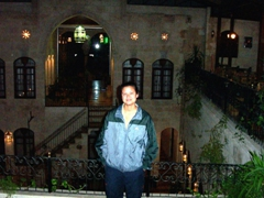 Becky standing on the balcony of our posh Aleppo hotel