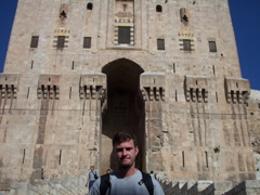 Robby at the 12th century fortified gate of Aleppo's citadel