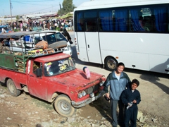 Becky and a friendly boy; roadside market somewhere between Halabiyyeh to Mari