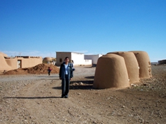 Becky at an adobe beehive village