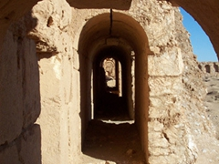 View down the covered archway tunnel which was built right up against the perimeter wall; Resafa