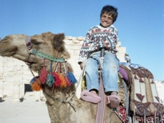 An adorable Syrian boy tries to convice us to go for a whirl; Palmyra