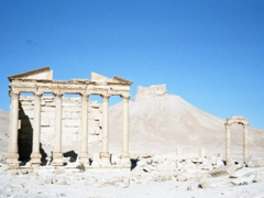 """The Temple of the Standards (also referred to as the """"Ruins of the Perystil, Grave Temple"""") with the Arab Castle behind; Palmyra"""