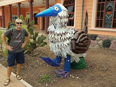 Robby next to a blue footed booby (made from recycled plastic); near Playa Mann