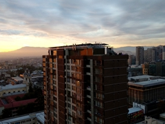 Sunset from our 26th floor apartment in Santiago