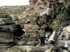 Robby admiring the rock formations at the base of the rockhopper penguin colony