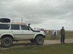 Robby standing beside the 4WD vehicle that is necessary to go from Johnson's Harbour to Volunteer Point