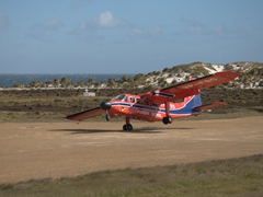 Our FIGAS plane landing on the tiny airstrip