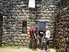 Standing in the stone house ruins near the summit of Huayna Picchu