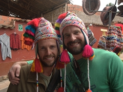 Robby and John model colorful Peruvian hats