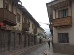 Carved wooden balconies on every street in historical Cusco