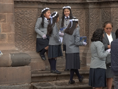 Girls dressed in their best outside the Jesuit church in Cusco