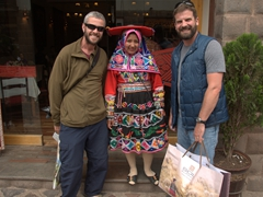 Robby and John next to a woman dressed in colorful indigenous clothes