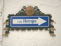 Ornate street sign in historical Cusco