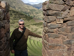 Robby in front of the agricultural terraces carved into the steep hillside; Pisac
