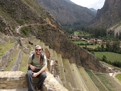 Robby sitting in front of agricultural terraces; Ollantaytambo