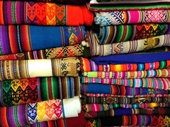 Colorful tablecloths for sale at the market in Aguas Calientes