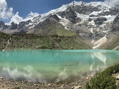 Humantay Lake - a vibrant turquoise lake surrounded by snowcapped mountains
