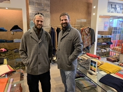 Robby and John modeling alpaca jackets - super soft to the touch!