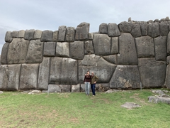 Dwarfed by the monstrous stone wall of Sacsayhuamán, built entirely without mortar!