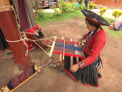 A lady demonstrates the traditional Andean weaving process; Chinchero textile center
