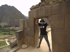 Becky supporting the fortress door frame; Ollantaytambo