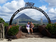 Posing by the Mistico hanging bridges signpost