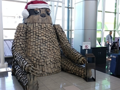 Wooden sloth display at the San Jose airport
