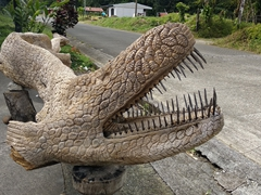 Intricately carved crocodile; La Fortuna