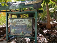 Signpost for Manuel Antonio, a world renowned park for sloths, a myriad of bird life, and cheeky capuchin monkeys
