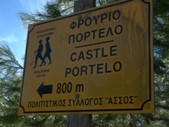 Sign indicating the footpath up to the rear of the Fortress of Assos