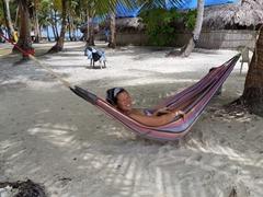 Becky relaxing in a hammock; Demar Achudup Island