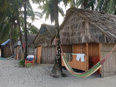 Beach huts with hammocks; Ina Island