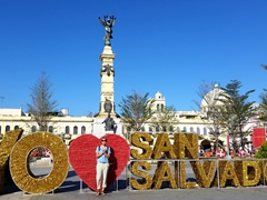 "Becky standing in front of the ""I love San Salvador"" sign at Plaza Libertad (Liberty Square); San Salvador"