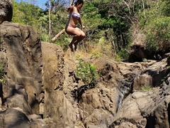 Becky jumping from the 6 meter waterfall; Tamanique