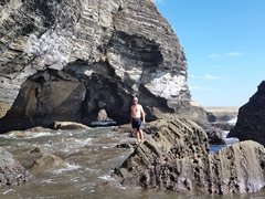 Robby posing near the beach caves of El Tunco (which can only be visited during low tide)