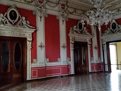 The red room (salon rojo) of the National Palace is used for receptions held by the Salvadoran Foreign Ministry
