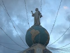 Monument to the Divine Savior of the World, a statue of Jesus Christ standing on top of the world