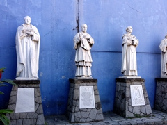 Statues (including Christopher Columbus to the far right) at El Rosario Church; San Salvador