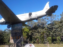 Special Forces recruiting plane by the roadside; San Salvador