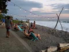 Tourists enjoying a sundowner in El Tunco