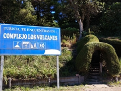 Signpost reminding tourists they are in the center of the  Los Volcanes National Park, home to 3 volcanoes (Cerro Verde, Izalco, and Santa Ana)